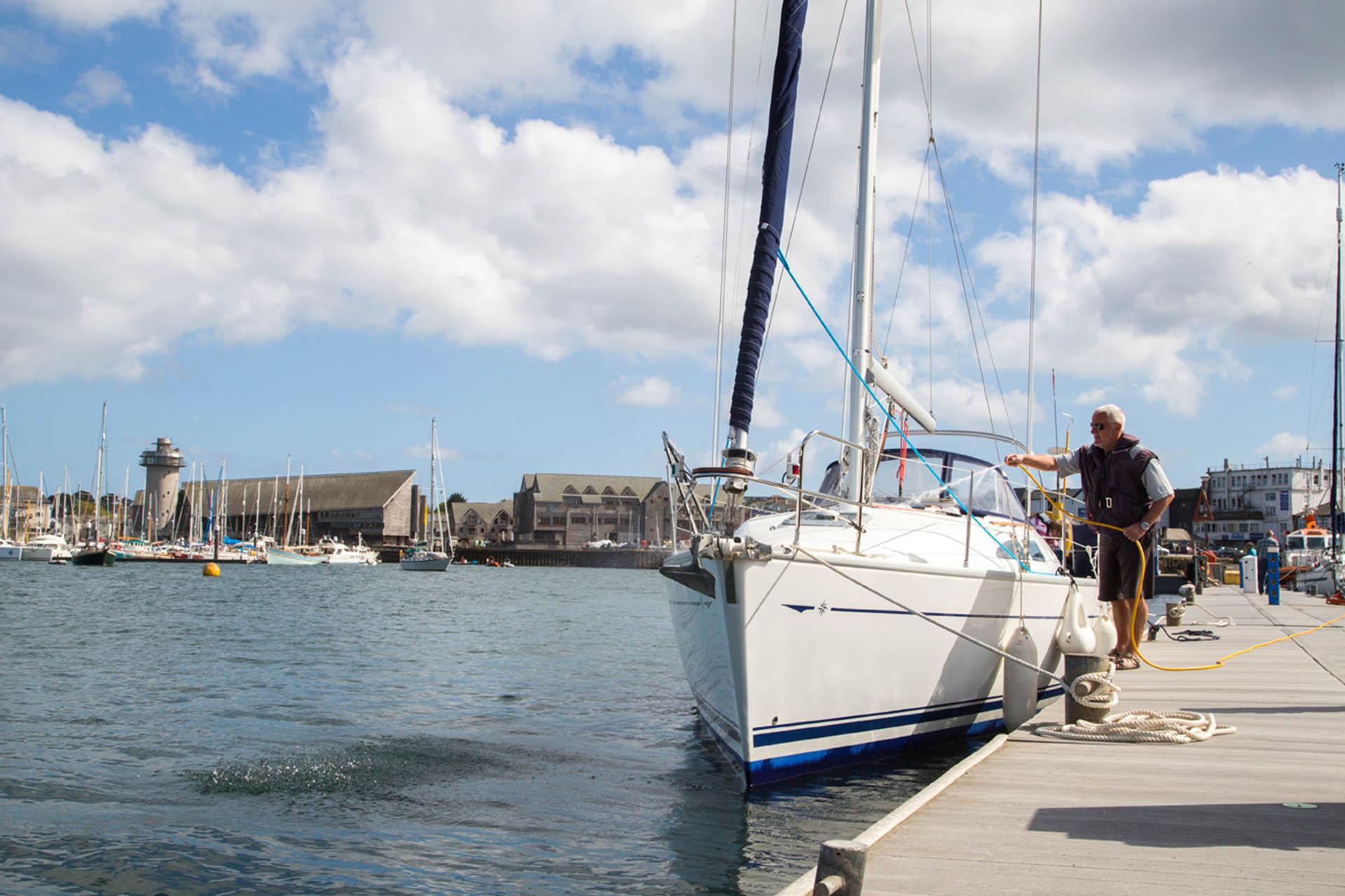 Falmouth-Haven-pontoon-washing-boat